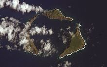 Satellite photograph of the northern islands: green islands in the blue sea, partly obscured by clouds.