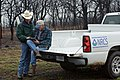NRCS District Conservationist Tony Dean (right) discuss ranch management options with a Jack County landowner after a wildfire burned through the area three weeks earlier. (24484798823).jpg