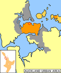 Auckland City's urban areas (in orange) within the greater Auckland urban region (grey). The city centre is ringed. Auckland City also encompassed islands of the inner (upper right) and outer Hauraki Gulf.