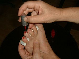 Applying nail polish on toes