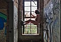 Naked man looking out the window inside an abandoned military building in Fort de la Chartreuse, Liege, Belgium (DSCF3410).jpg