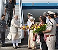 Narendra Modi being received by the Governor of Goa, Smt. Mridula Sinha, the Chief Minister of Goa, Shri Laxmikant Parsekar and the Union Minister for Defence, Shri Manohar Parrikar, on his arrival in Goa.jpg