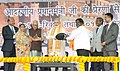 Narendra Modi presenting rickshaw keys to the beneficiaries of Rickshaw Sangh Package, at the function organised by the Rickshaw Sangh, at Varanasi, Uttar Pradesh. The Governor of Uttar Pradesh.jpg