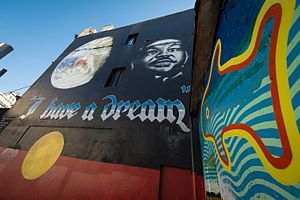 Newtown area graffiti and street art -  Andrew Aiken/Juilee Pryor: Martin Luther King Mural on King St, Newtown, 1991.