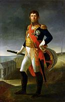 Painting of a standing man with a bicorne hat in his left hand and his right hand holding a marshal's baton. He wears a dark blue military coat with much gold braid, white breeches, black knee boots and a red sash across his chest. His face has a cleft chin and a stern look under dark hair.