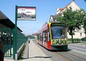 Tram-train - A Nordhausen 'DUO' Combino on the track linking the urban tramway, where it is electrically powered via overhead wires, and the HSB (Harzer Schmalspurbahn) rural railway, where it is powered by an onboard diesel engine