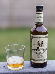 Old Overholt Rye Whiskey bottle and tumbler.jpg