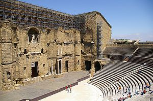 Roman Theatre of Orange - The Orange theatre is one of few Roman theatres which still retains the Scaenae frons, at the rear of the stage, though stripped of its elaborate decoration.