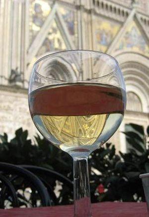 Orvieto DOC - A glass of white Orvieto wine near the Duomo di Orvieto