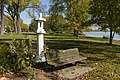 "Park bench and Sid Boyum sculpture ""Fu Dog Lantern"" in Yahara Place Park, Madison, Wisconsin.jpg"