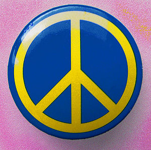 Pin-back button - A peace symbol on a pin-back button
