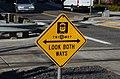 Pedestrian warning sign at crossing of MAX Light Rail tracks near Orenco station.jpg