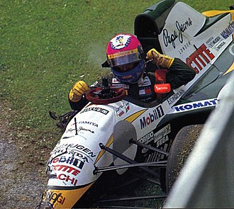 Lotus 107 - Pedro Lamy leaving his wrecked 107C at the 1994 San Marino Grand Prix after hitting JJ Lehto's stalled Benetton, causing an early safety car.
