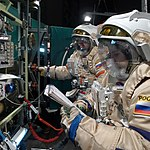 Performing airlock operations with colleague Alex (8147305621).jpg