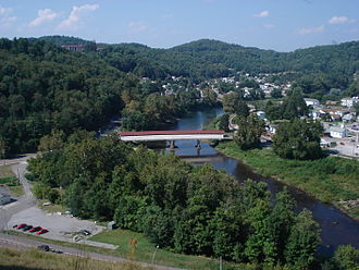 "Barbour County, West Virginia - View of Philippi, county seat of Barbour County. Visible are the historic Philippi Covered Bridge spanning the Tygart Valley River and the main administrative building and chapel of Alderson Broaddus University atop ""Battle Hill"" (upper left) overlooking the town."