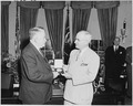 Photograph of President Truman presenting a Gold Medal authorized by Congress to Vice President Alben Barkley, in the... - NARA - 200219.tif