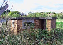 Low-slung reinforced brick gun emplacement, with two long horizontal gun-slit windows