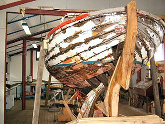 Boat building - Damaged boat mid-reconstruction; carvel planking partially removed