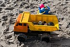 Plastic toy truck and pail in sand.jpg