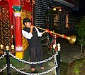 Playing trumpet at temple. Mandi, Himachal Pradesh.jpg