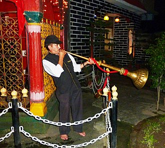 Mandi State - Playing trumpet at temple. Mandi, Himachal Pradesh