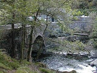 Pont Aberglaslyn Grade II listed building in Gwynedd. Spanning the Afon Glaslyn approximately 1km W of Nantmor.