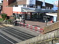 Poole High Street level crossing - barriers down in advance of a train 2005-07-16.jpg