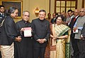 Pranab Mukherjee being presented a copy of the book 'Reflections on Contemporary India', authored by the Governor of Chhattisgarh, Shri Shekhar Dutt, at Rashtrapati Bhavan, in New Delhi. The Speaker, Lok Sabha.jpg