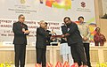"""Pranab Mukherjee presenting the Rajat Kamal Special Jury Award for the film of """"A Poet, A City & A Footballer"""", in Non Feature Films Section to the Director, Joshy Joseph, at the 62nd National Film Awards Function.jpg"""