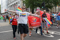 Pride in London 2016 - An LGBT Tottenham supporter with Arsenal supporters in the parade.png