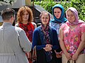 Priest with Women Devotees - Outside St. Nikolai's Church - Brest - Belarus (27337380952).jpg