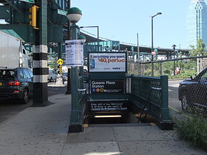 Queens Plaza (IND Queens Boulevard Line) - Station entrance at 41st Avenue and Northern Boulevard. Overhead is the BMT Astoria Line. Off to the right (although out of sight in this photo) is Queensboro Plaza station.