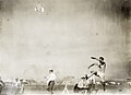 R.S. Strangland of the New York Athletic Club winning third place in the running broad jump at the 1904 Olympics.jpg