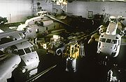 Three helicopters in the hangar of Nimitz
