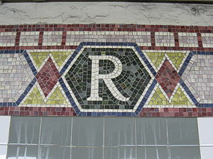 "Rector Street (IRT Broadway–Seventh Avenue Line) - Close-up of one of the wall mosaics with the letter ""R"""