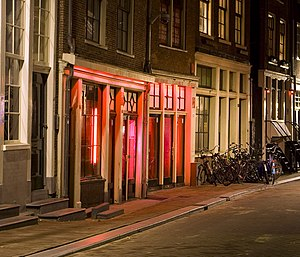 Red-light district - Rooms illuminated by red lights in an Amsterdam red-light district