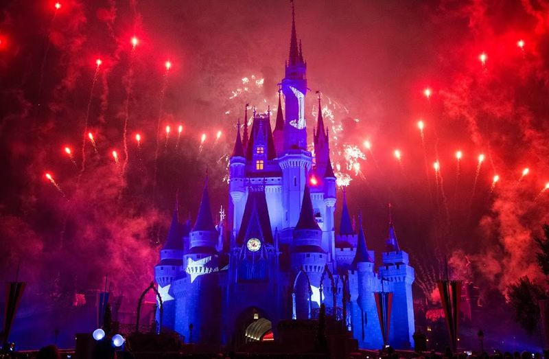 File:Red fireworks surround night sky beside Cinderella Castle, Magic Kingdom.jpg