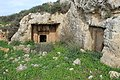 Rock-carved tomb at Kh. Jurish (ruin).jpg
