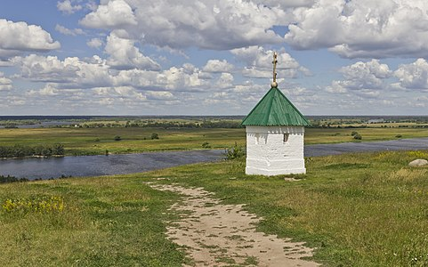 View to Oka River in Konstantinovo (museum-reserve in the home village of famous poet S.A.Yesenin), Ryazan region, Russia, with white chapel located at the former cemetery.