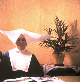 Daughters of Charity of Saint Vincent de Paul - Until 1964, their traditional religious habit included a large, starched cornette on the head.
