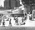 SLNSW 12058 Corner of Manly Beach showing the new surfing pavilion in background for Building Publishing Co and Far West Home children leaving the beach.jpg