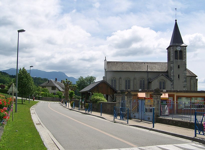 Sight of commune of Saint-Girod city center and its church, in Savoie, France.