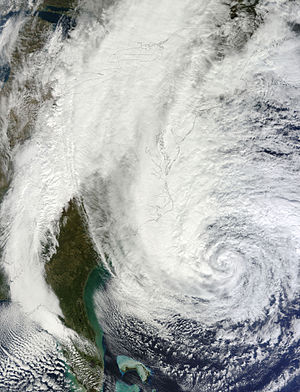 Hurricane Sandy - A tilted satellite image of the storm on October 28, with most of the U.S. coastline artificially highlighted. The entire east coast is visible, with a cloudless Florida coast seen at the bottom of the image and the outline of the coast of Maine at the top right.