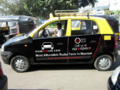 Santro Black and Yellow taxi.png