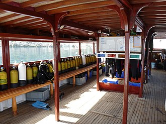 Dive boat - Deck of a dive boat for about 35 divers, with equipment and whiteboard for dive planning
