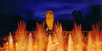 """Sentosa Musical Fountain - """"Spirits of Sentosa"""" show in 1999, with the Merlion in the background."""