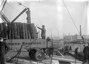 Shannon hydroelectric scheme - Siemens-Bauunion plant and machinery being unloaded at Limerick docks for Shannon hydro-electric scheme, 1925