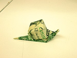 Origami paper - An origami snail that is made out of a dollar bill.