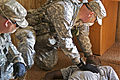 Soldiers from Alpha Company, 4th Battalion, 118th Infantry Regiment, 218th Maneuver Enhancement Brigade, assist a role player acting the part of an injured victim during Exercise Palmetto Response, in McCormick 110613-A-DH163-008.jpg