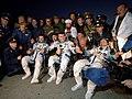 Soyuz TMA-5 crew after landing.jpg